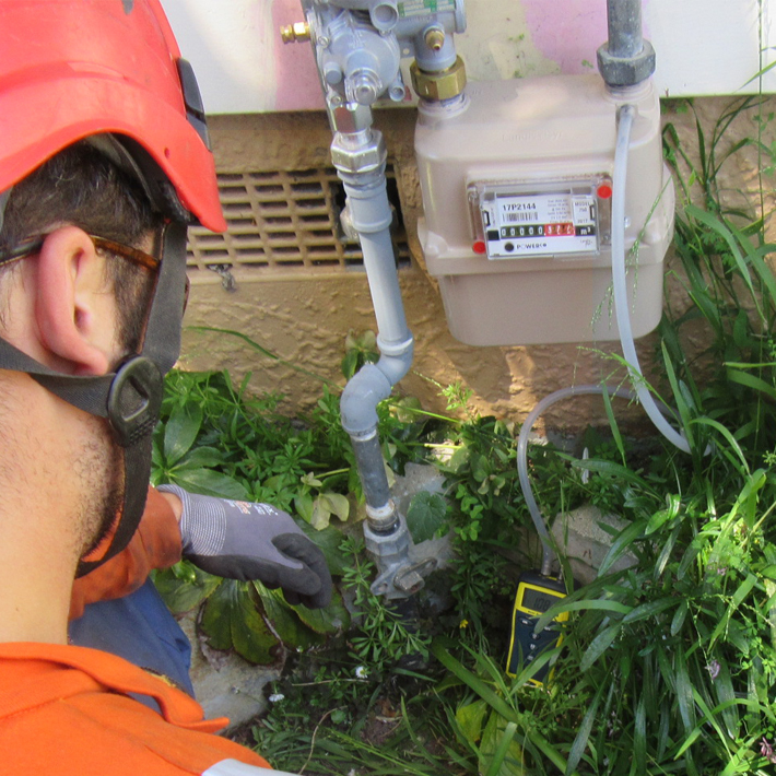 Gasfitter checking gas meter