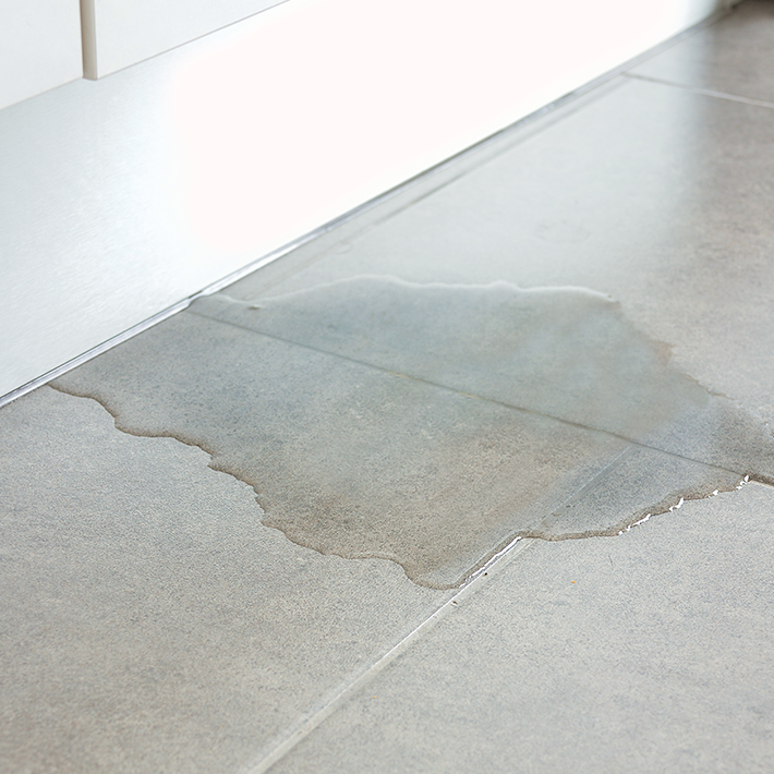 Hot water leaking on floor