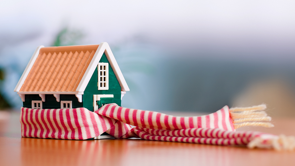 Miniature house wrapped in scarf